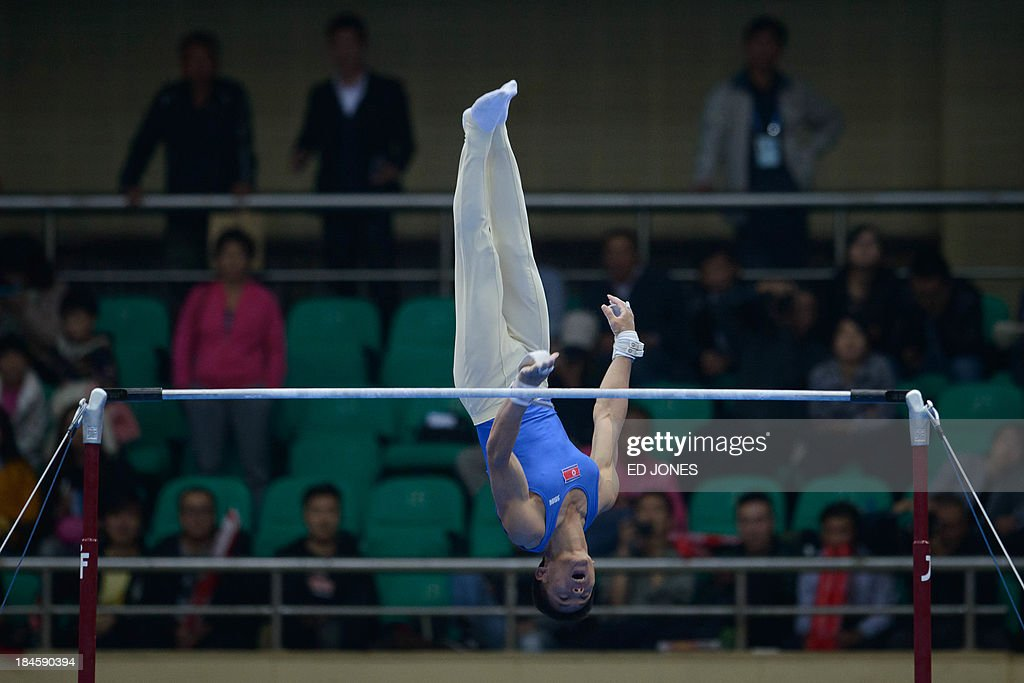 North Korea's Kim Kwang Chun competes in the Men's Horizontal Bar final event of the 6th East Asian Games in Tianjin on October 14, 2013. The eastern Chinese city is hosting the East Asian Games which sees nine countries participating in 262 events across 22 different sports. AFP PHOTO / Ed Jones