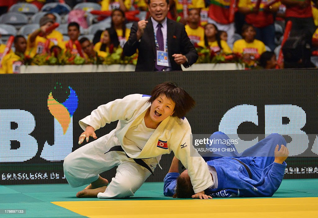 North Korea's Kyong Sol (white) reacts after winning against Catherine Roberge in a women's -78kg category semifinal, during the IJF World Judo Championship, in Rio de Janeiro, Brazil, on August 30, 2013.