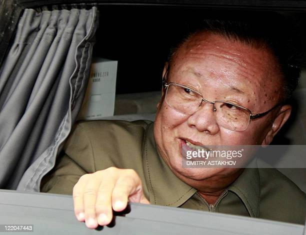 North Korea's leader Kim JongIl looks out of a car window after the meeting with Russian President dmitry Medvedev at Sosnovy Bor Military Garrison...
