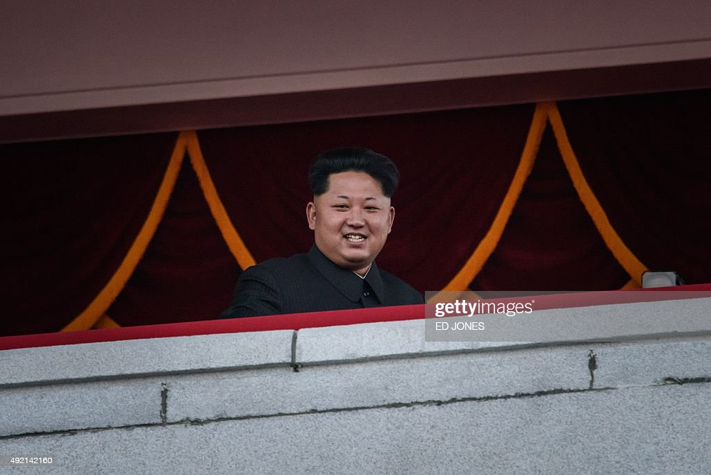 North Korea's leader Kim Jong-Un looks out towards Kim Il-Sung square during a mass military parade in Pyongyang on October 10, 2015. North Korea was marking the 70th anniversary of its ruling Workers' Party. AFP PHOTO / Ed Jones