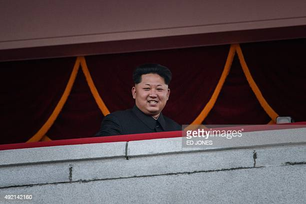 North Korea's leader Kim JongUn looks out towards Kim IlSung square during a mass military parade in Pyongyang on October 10 2015 North Korea was...