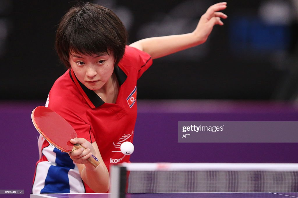 North Korea's Myong Sun Ri plays against Austria's Jia Liu on May 17, 2013 in Paris, during the fourth round of Women's Singles of the World Table Tennis Championships. AFP PHOTO / THOMAS SAMSON