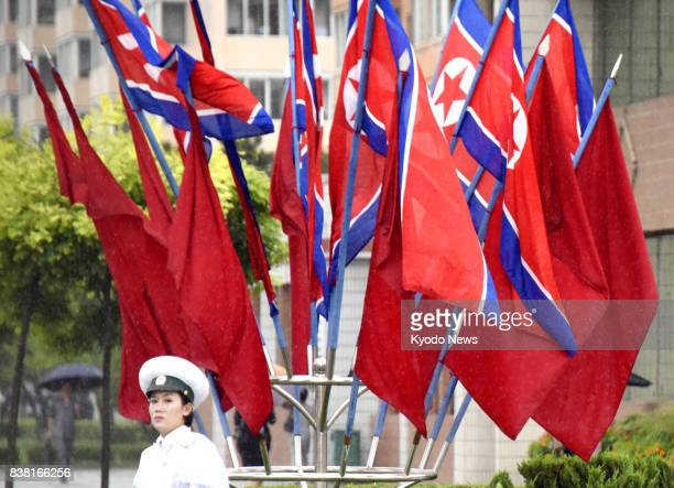 North Korea's national flags are displayed in Pyongyang on Aug 24 a day before the Day of Songun a national holiday celebrating the military...
