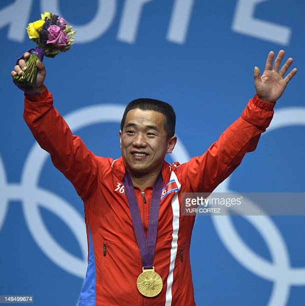 North Korea's Om Yun Chol celebrates with his gold medal on the podium for the weightlifting men's 56kg at the Excel Center in London during the 2012...