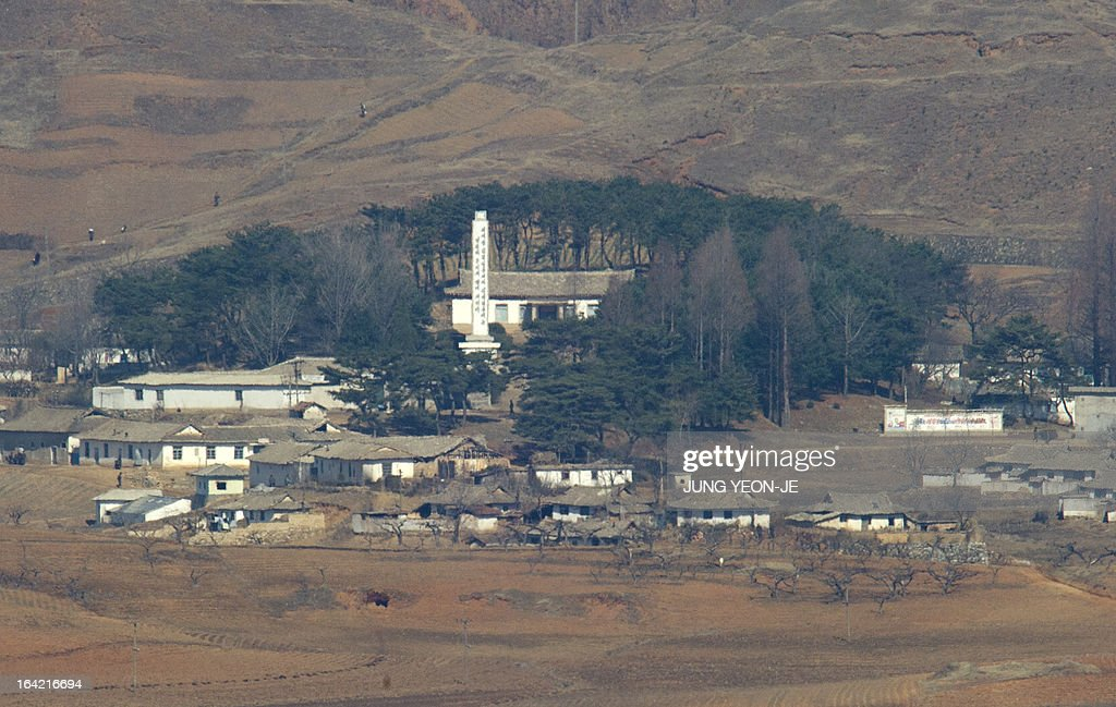 North Korea's propaganda village of Gijeongdong is seen from a South Korean observatory post in the border city of Paju near the Demilitarized Zone (DMZ) dividing the two Koreas on March 21, 2013. North Korea issued an air raid warning and put its military on alert on March 21, South Korea's Unification Ministry said, in what appeared to be a drill at a time of heightened tensions.