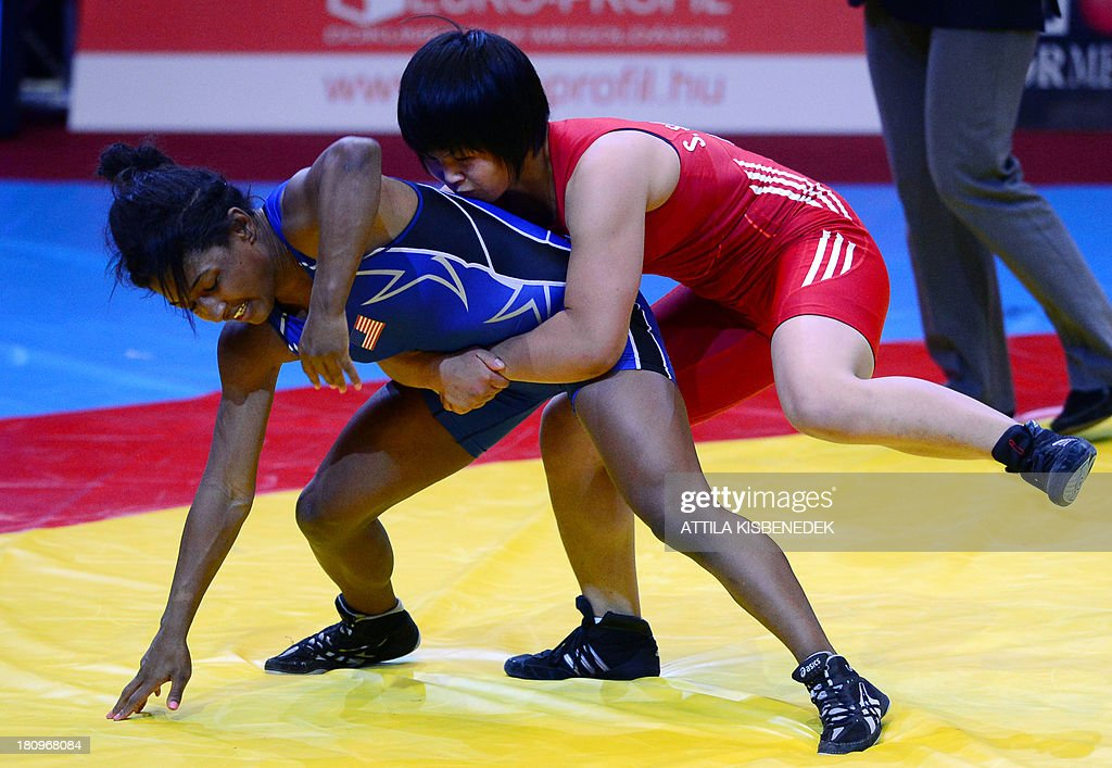 North Korea's Sim Hyang So (red) fights against US Victoria Lacey Anthony (blue) at their repechage women's free style 51 kg fight of the FILA World Wrestling Championships in Budapest on September 18, 2013.