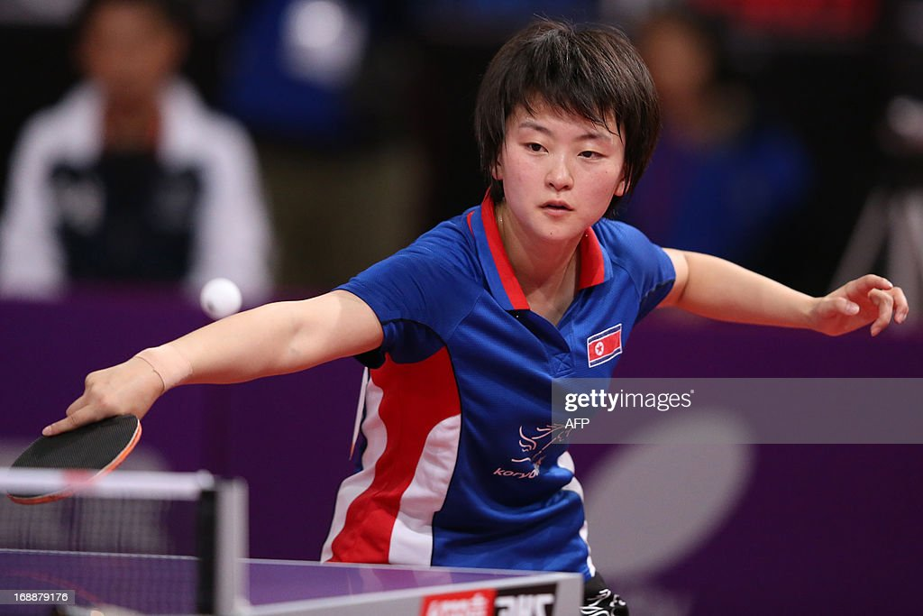 North Korea's Sun Ri Myong competes during the third round of the Women's Singles of the World Table Tennis Championships in Paris on May 16, 2013. North Korea's Sun Ri Myong plays against Japan's Kasumi Ishikawa. AFP PHOTO / THOMAS SAMSON
