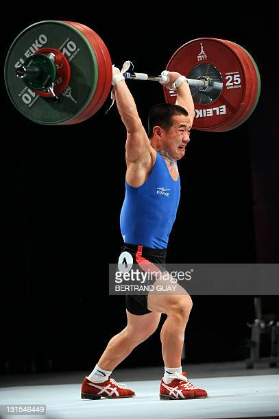 North Korea's Yun Chol Om competes during the 2011 World Weightlifting Championships' finals in the 56 kg men's weight class on November 5 2011 in...
