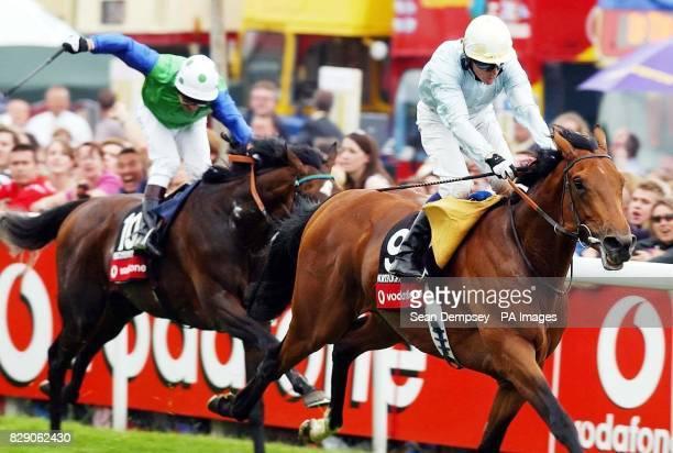 North Light ridden by jockey Kieren Fallon winning in the Vodaphone Derby Stakes at Epsom Saturday June 5 2004