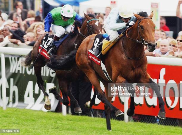 North Light ridden by jockey Kieren Fallon wins in the Vodaphone Derby Stakes at Epsom Saturday June 5 2004