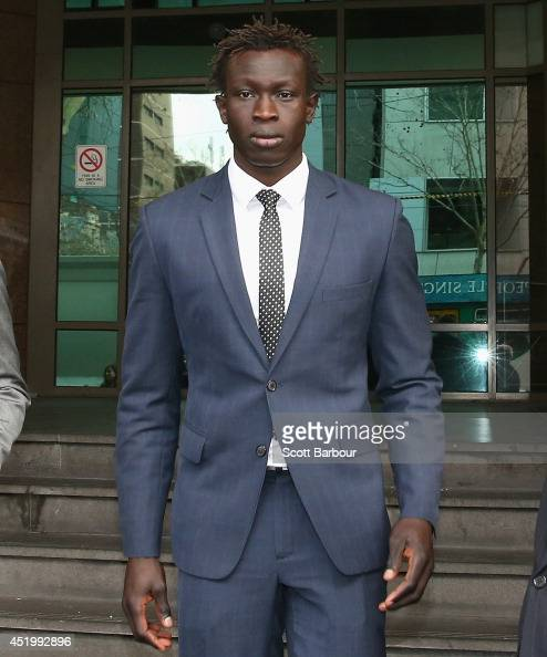 North Melbourne AFL player Majak Daw leaves the Melbourne Magistrates Court on July 11 2014 in Melbourne Australia Police have charged Daw with three...