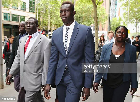 North Melbourne Kangaroos AFL player Majak Daw appears at Victorian County Court with his parents William Daw and Elizabeth Daw on November 23 2015...