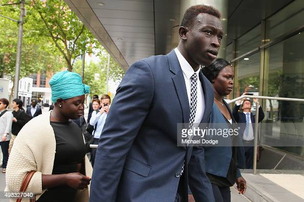 North Melbourne Kangaroos AFL player Majak Daw appears at Victorian County Court with his family on November 23 2015 in Melbourne Australia Daw is...