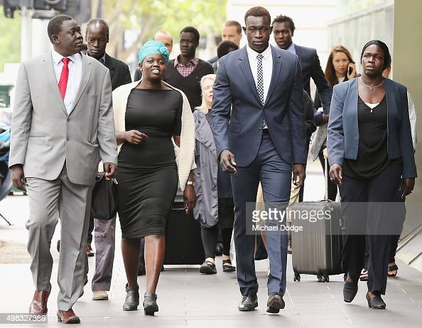 North Melbourne Kangaroos AFL player Majak Daw appears at Victorian County Court with his parents William Daw and Elizabeth Daw and other family...