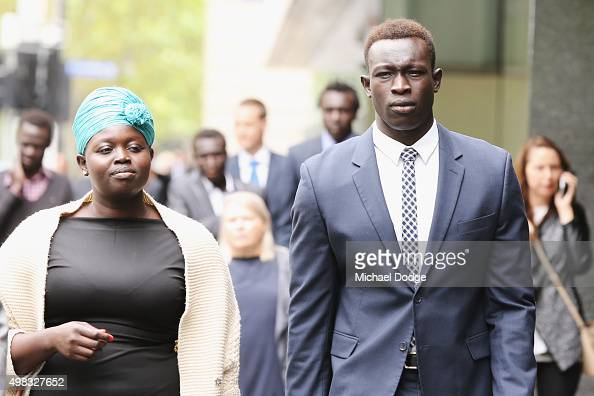 North Melbourne Kangaroos AFL player Majak Daw appears at Victorian County Court with sister Sarah Daw on November 23 2015 in Melbourne Australia Daw...