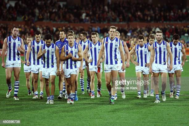 North Melbourne players leave the field after the round 13 AFL match between the Adelaide Crows and the North Melbourne Kangaroos at Adelaide Oval on...