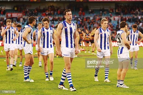 North Melbourne players react after the round 20 AFL match between the Adelaide Crows and the North Melbourne Kangaroos at AAMI Stadium on August 11...