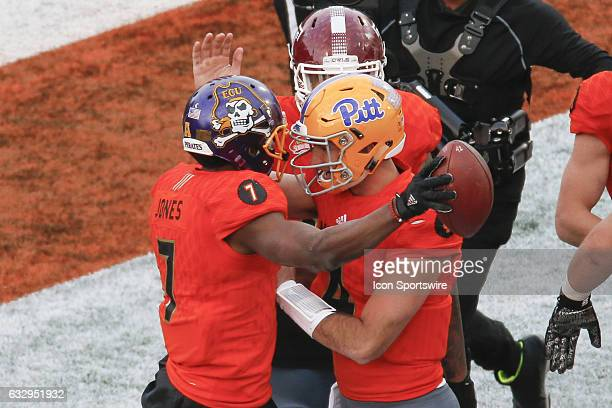 North Team Zay Jones and North Team Nate Peterman celebrate a touchdown pass during the 2017 Senior Bowl college football game at LaddPeebles Stadium...