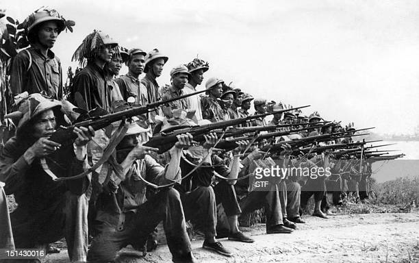 North Vietnamese forces are ready for firing during a military exercice in Bach Dang near Hanoi during the Vietnam war 19 July 1966