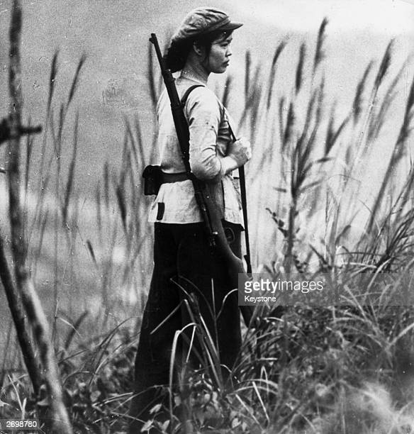North Vietnamese soldier Nguen ThiHai standing guard