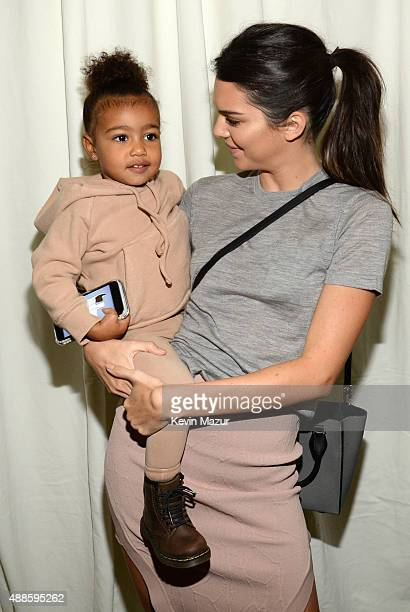 North West and Kendall Jenner attend Kanye West Yeezy Season 2 during New York Fashion Week at Skylight Modern on September 16 2015 in New York City
