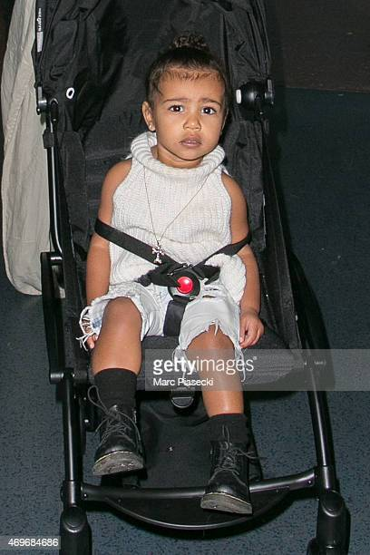 North West is seen at the CharlesdeGaulle airport on April 14 2015 in Paris France