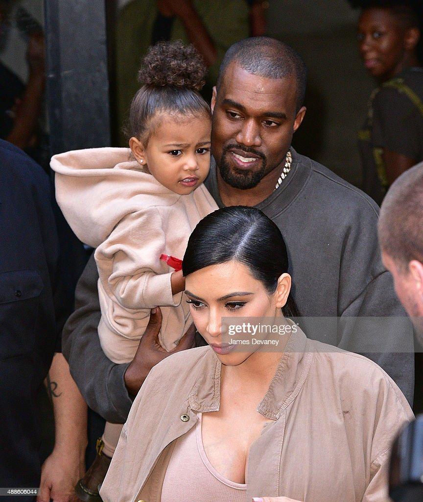 North West Kanye West and Kim Kardashian leave Kanye West Yeezy Season 2 New York Fashion Week show at Skylight Modern on September 16 2015 in New...