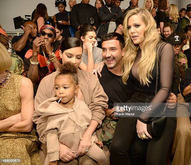 North West Kim Kardashian West Riccardo Tisci and Khloe Kardashian attend Kanye West Yeezy Season 2 during New York Fashion Week at Skylight Modern...