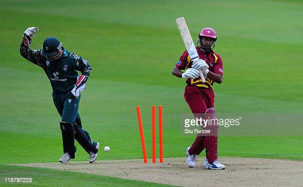 Northampton batsman Chaminda Vaas looks on after being bowled as wicketkeeper Ben Scott celebrates during the Friends Life T20 game between...