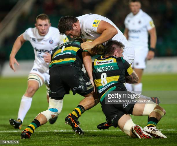 Northampton Saints' Alex Waller and Teimana Harrison combine to stop Bath Rugby's Charlie Ewels in his tracks during the Aviva Premiership match...