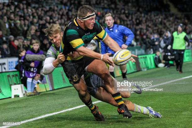 Northampton Saints' Alex Waller is tackled by Newcastle Falcons' Chris Harris during the Aviva Premiership match between Northampton Saints and...