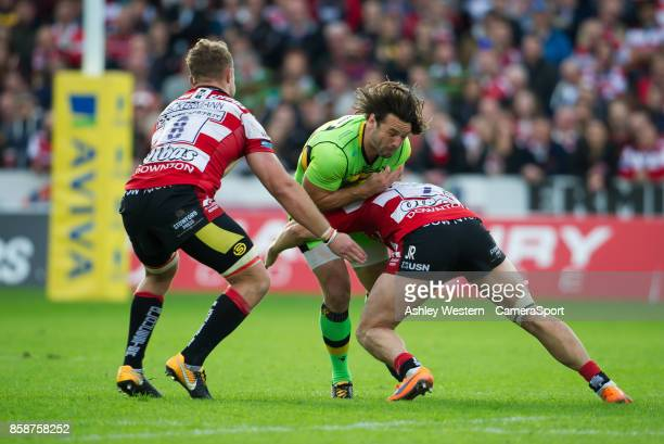 Northampton Saints' Ben Foden is tackled by Gloucester Rugby's Jacob Rowan during the Aviva Premiership match between Gloucester Rugby and...