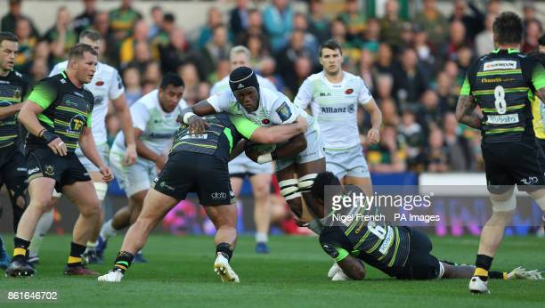 Northampton Saints Kieran Brookes and Courtney Lawes tackle Saracens Maro Itoje during the Champions Cup match at Franklin's Gardens Northampton
