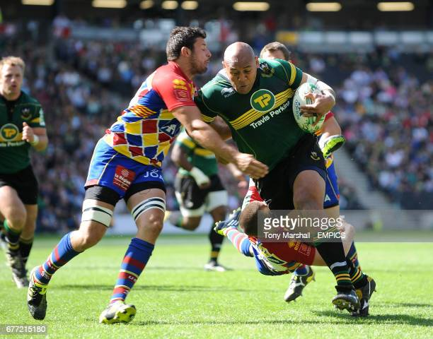 Northampton Saints' Soane Tonga'uiha tackled by USA Perpignan's Damien Chouly and David Mele