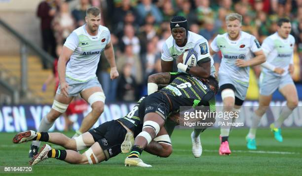 Northampton Saints Tiemana Harrison and Courtney Lawes tackle Saracens Maro Itoje during the Champions Cup match at Franklin's Gardens Northampton