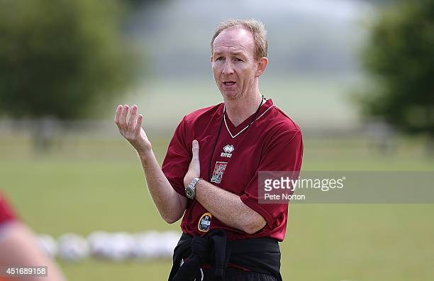 Northampton Town assistant manager Alan Knill gives instructions during a training session at Moulton College on July 4 2014 in Northampton United...