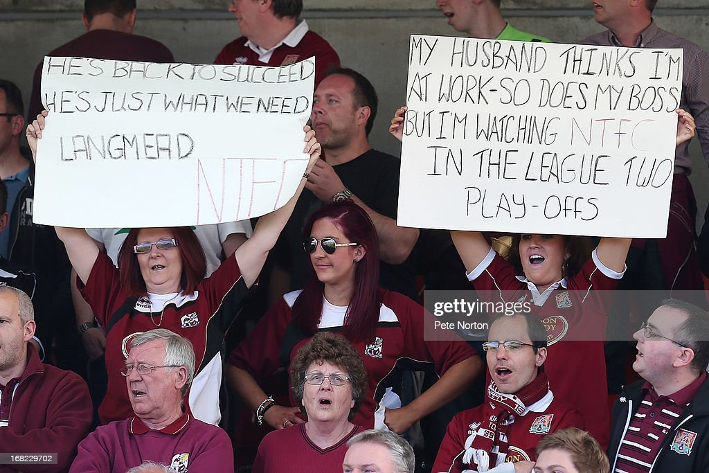 Northampton Town fans hold up signs during the npower League Two Play Off Semi Final Second Leg between Cheltenham Town and Northampton Town at Abbey Business Stadium on May 5, 2013 in Cheltenham, England.