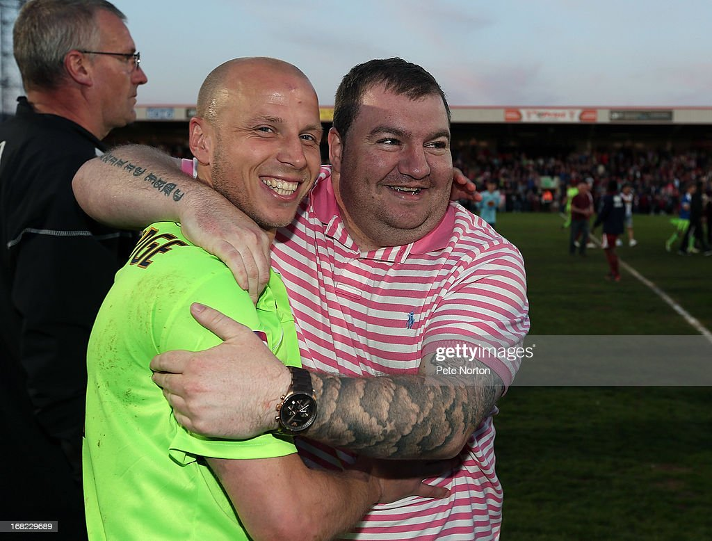 Northampton Town goalscorer Luke Guttridge celebrates with fans at the end of the npower League Two Play Off Semi Final Second Leg between Cheltenham Town and Northampton Town at Abbey Business Stadium on May 5, 2013 in Cheltenham, England.