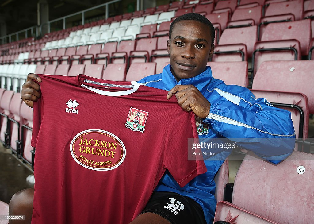Northampton Town loan signing Emmanuel Oyeleke poses with a shirt during a photo call at Sixfields Stadium on January 28, 2013 in Northampton, England.