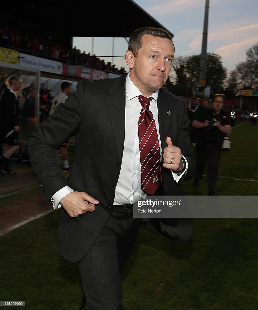 Northampton Town manager Aidy Boothroyd celebrates victory at the end of the npower League Two Play Off Semi Final Second Leg between Cheltenham Town and Northampton Town at Abbey Business Stadium on May 5, 2013 in Cheltenham, England.