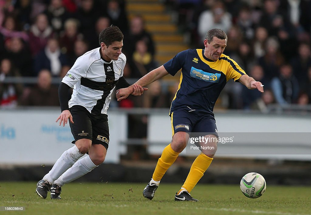 Northampton Town manager Aidy Boothroyd (R) controls the ball under pressure from Actor Matt Lapinskas during the William Hill Foundation Cup Celebrity Charity Challenge Match at Sixfields on December 9, 2012 in Northampton, England.