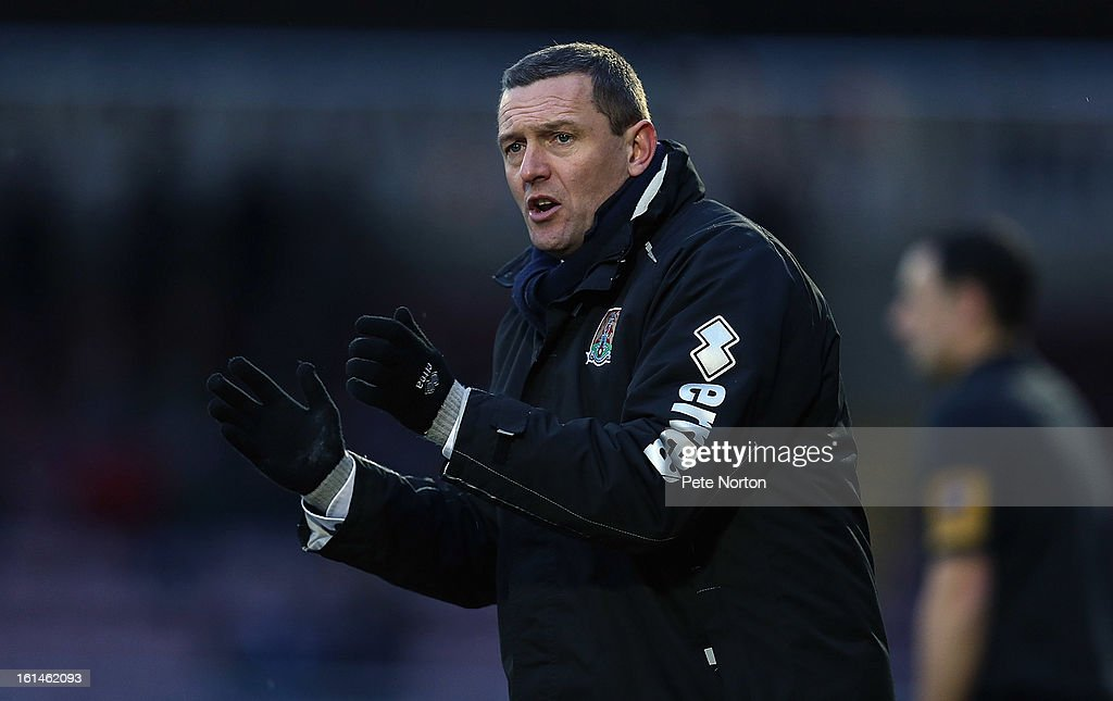 Northampton Town manager Aidy Boothroyd looks on during the npower League Two match between Northampton Town and Rochdale at Sixfields Stadium on February 9, 2013 in Northampton, England.