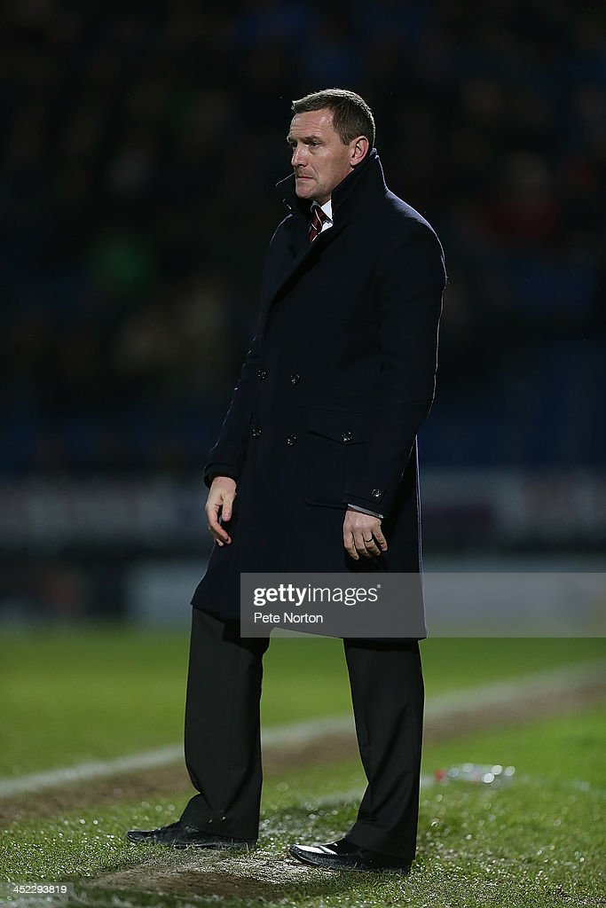 Northampton Town manager Aidy Boothroyd looks on durng the Sky Bet League Two match between Chesterfield and Northampton Town at Proact Stadium on November 26, 2013 in Chesterfield, England.