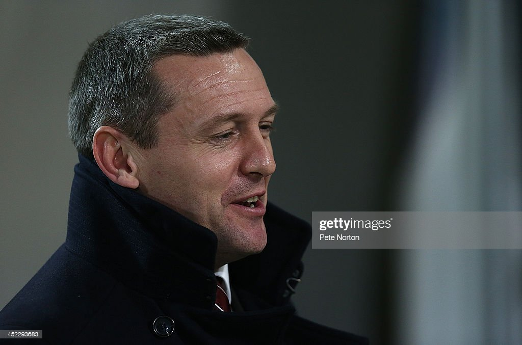 Northampton Town manager Aidy Boothroyd looks on prior to the Sky Bet League Two match between Chesterfield and Northampton Town at Proact Stadium on November 26, 2013 in Chesterfield, England.