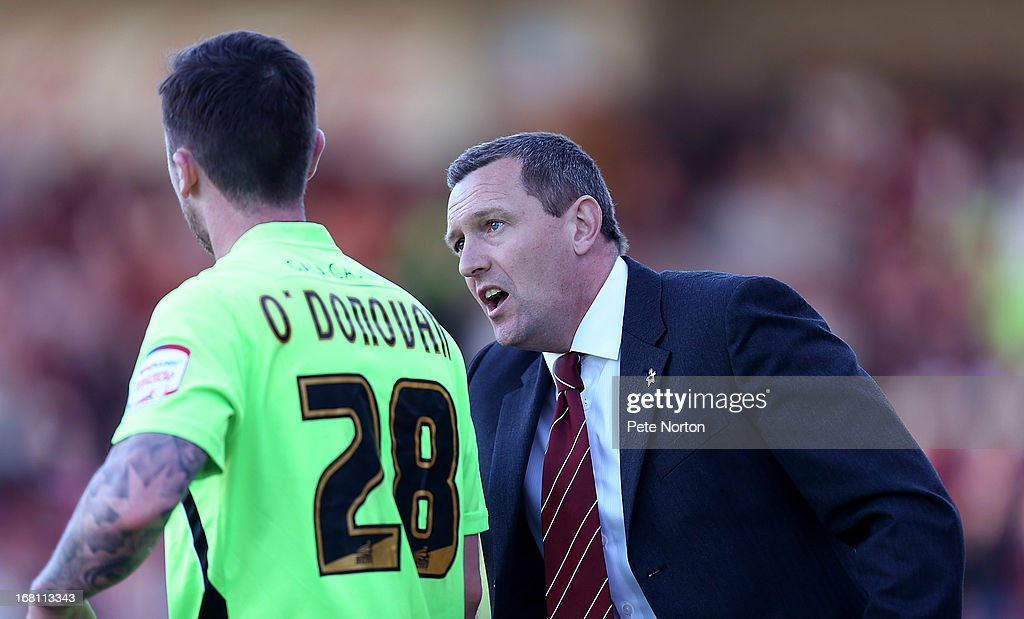 Northampton Town manager Aidy Boothroyd makes a point to Roy O'Donovan during the npower League Two Play Off Semi Final Second Leg between Cheltenham Town and Northampton Town at Abbey Business Stadium on May 5, 2013 in Cheltenham, England.