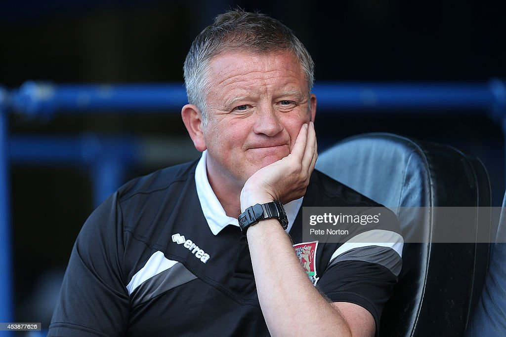 Northampton Town manager Chris Wilder looks on prior to the Sky Bet League Two match between Portsmouth and Northampton Town at Fratton Park on August 19, 2014 in Portsmouth, England.