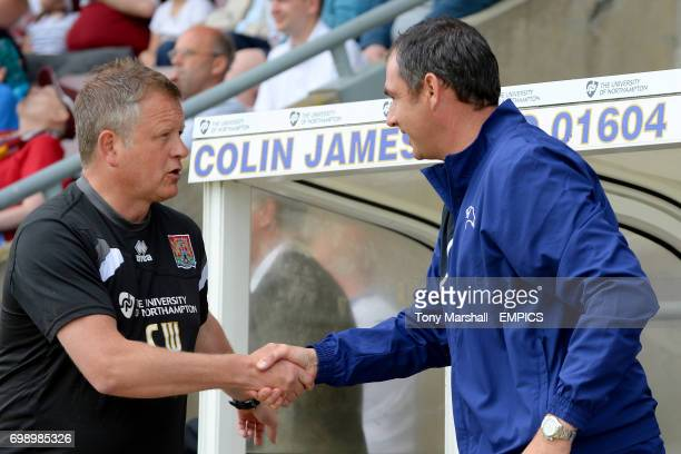 Northampton Town manager Chris Wilder shakes hands with Derby County Manager Paul Clement