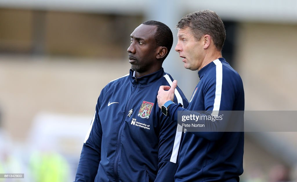 Northampton Town manager Jimmy Floyd Hasselbaink and his assistant Dean Austin look on during the Sky Bet League One match between Northampton Town and A.F.C. Wimbledon at Sixfields on October 14, 2017 in Northampton, England.