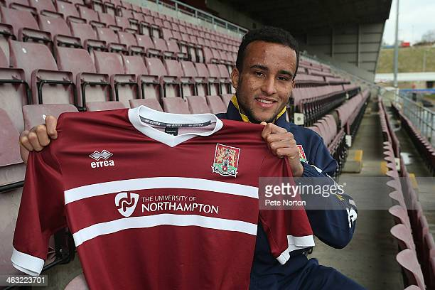 Northampton Town new loan signing James Hurst poses with a shirt during a photo call at Sixfields on January 17 2014 in Northampton England