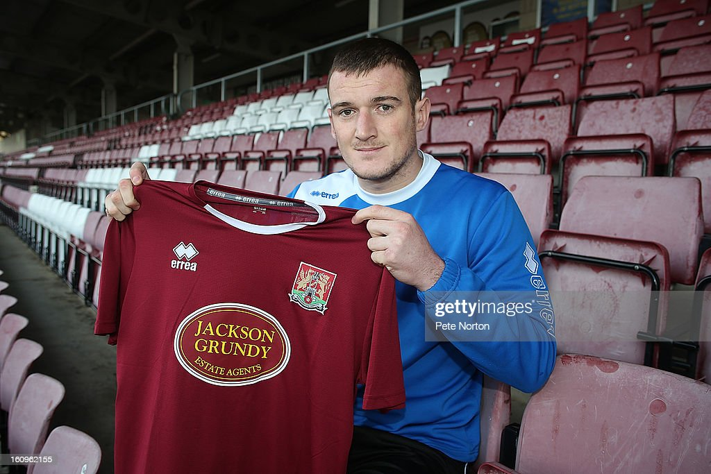 Northampton Town new signing Lee Collins poses with a shirt during a photo call at Sixfields Stadium on February 8, 2013 in Northampton, England.